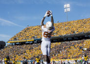 Texas wide receiver Malcolm Epps (85) catches a touchdown pass during the first half of an NCAA college football game Saturday against West Virginia, Oct. 5, 2019, in Morgantown, W.Va. (AP Photo/Raymond Thompson)