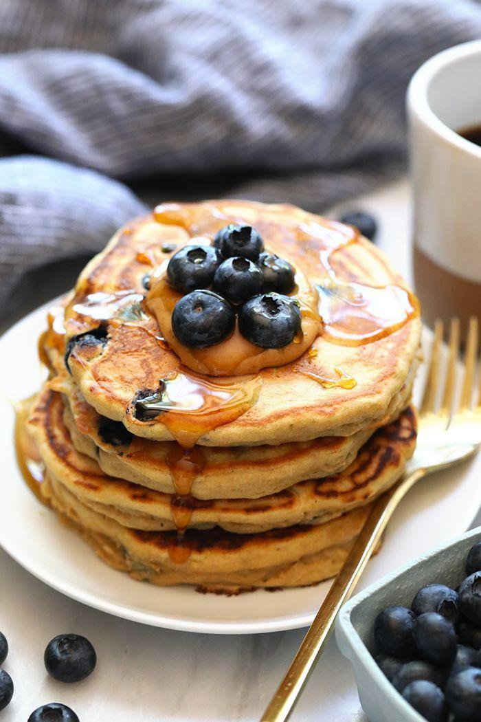 """<p>Blueberries and pancakes go hand in hand like Kanye and Kim, Beyonce and Jay-Z, banana and peanut butter. Get stuck in to this delicious recipe for a pick-me-up.</p><p>Try the recipe for yourself: <a class=""""link rapid-noclick-resp"""" href=""""https://fitfoodiefinds.com/blueberry-protein-pancakes/"""" rel=""""nofollow noopener"""" target=""""_blank"""" data-ylk=""""slk:fitfoodiefinds.com"""">fitfoodiefinds.com</a></p>"""