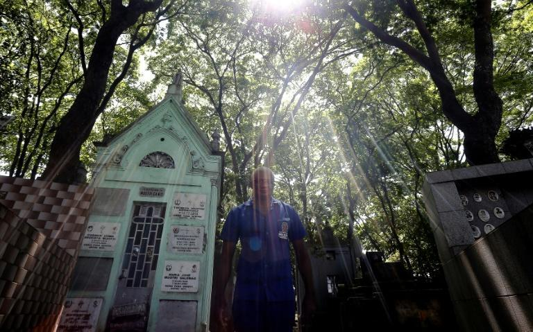 Osmair Candido has laid to rest more than 3,000 people in his three-decade gravedigging career in Brazil (AFP/Miguel SCHINCARIOL)