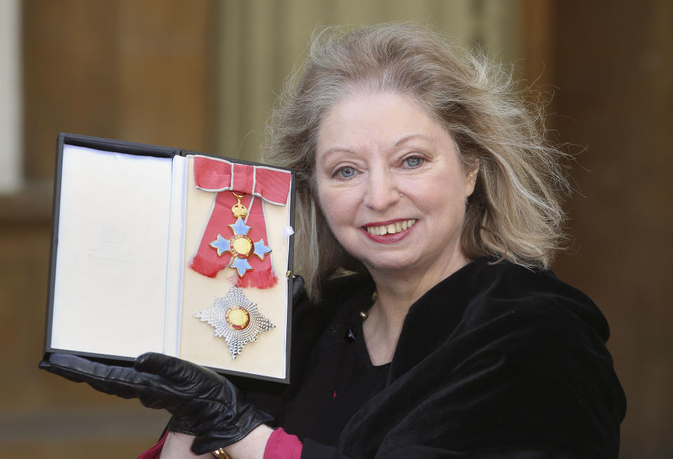 British author Hilary Mantel holds her Dame Commander of the Order of the British Empire (DBE) medal after it was presented to her by Britain's Prince Charles, Prince of Wales for services to literature at an Investiture ceremony at Buckingham Palace in London on February 6, 2015. AFP PHOTO / POOL / PHILIP TOSCANO (Photo by PHILIP TOSCANO / POOL / AFP) (Photo by PHILIP TOSCANO/POOL/AFP via Getty Images)