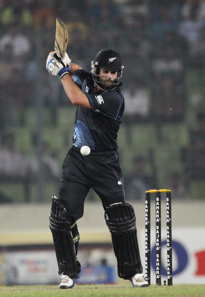New Zealand's Anton Devcich (R) plays a shot against Bangladesh during their second one-day international (ODI) cricket match in Dhaka October 31, 2013. REUTERS/Andrew Biraj (BANGLADESH - Tags: SPORT CRICKET)
