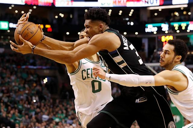 Apr 24, 2018; Boston, MA, USA; Milwaukee Bucks forward Giannis Antetokounmpo (34) drives against Boston Celtics forward Jayson Tatum (0) and guard Shane Larkin (8) during the second quarter of game five of the first round of the 2018 NBA Playoffs at TD Garden. Mandatory Credit: Winslow Townson-USA TODAY Sports TPX IMAGES OF THE DAY