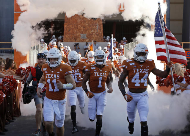Members of the Texas Longhorns enter the field before the game against LSU Tigers Saturday Sept. 7, 2019 at Darrell K Royal-Texas Memorial Stadium in Austin, Tx. ( Photo by Edward A. Ornelas )