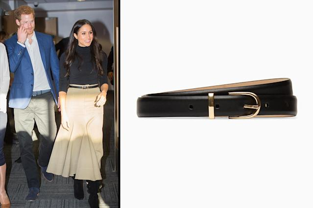 """<p>The first time Markle wore the skinny black belt from Aritzia was on an outing with Prince Harry to attend the Terrence Higgins Trust World AIDS Day charity fair in Nottingham, England, in December. (Photo: Getty Images; courtesy of Aritzia)<br>Don't miss your chance. Shop: Aritzia Babaton Amos dress belt, $45, <a href=""""https://us.aritzia.com/product/amos-dress-belt/55605.html?dwvar_55605_color=1461"""" rel=""""nofollow noopener"""" target=""""_blank"""" data-ylk=""""slk:aritzia.com"""" class=""""link rapid-noclick-resp"""">aritzia.com </a> </p>"""
