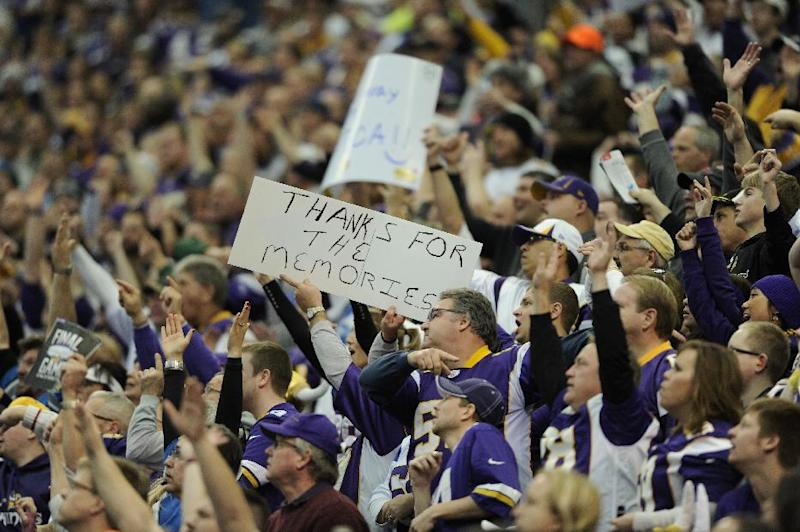 Fans hold up signs and cheer during the game between the Minnesota Vikings and the Detroit Lions on December 29, 2013 in Minneapolis, Minnesota