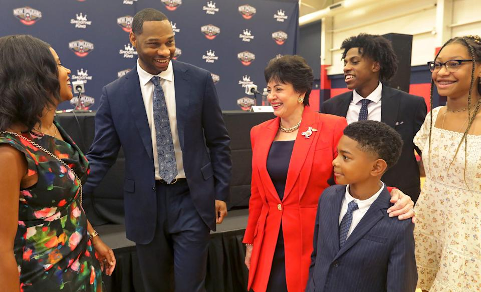 New Orleans Pelicans Governor Gayle Benson chats with Willie Green and his family after Green was introduced as the new head coach for the Pelicans.
