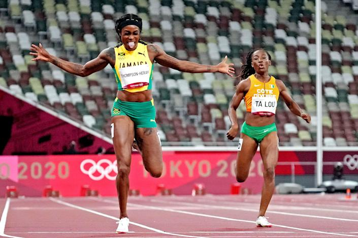 Elaine Thompson-Herah celebrates after winning the gold medal in the women's 200m final.
