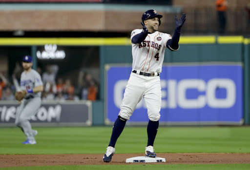 Houston Astros' George Springer celebrates after a double against the Los Angeles Dodgers during the first inning of Game 3 of baseball's World Series Friday, Oct. 27, 2017, in Houston. (AP)