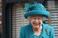 Britain's Queen Elizabeth II visits the set of the long running television series Coronation Street, in Manchester, England, Thursday July 8, 2021. (AP Photo/Scott Heppell)