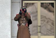 A North Korean soldier at the truce village of Panmunjom, in the Demilitarised Zone that divides the Korean peninsula on March 12, 2014