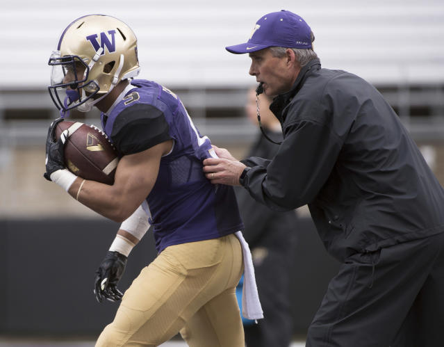 Chris Petersen is entering his fourth season at Washington. (AP)