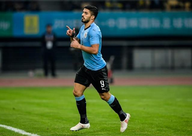 Barcelona forward Luis Suarez was the star as Uruguay cruised past the Czech Republic to reach the China Cup final