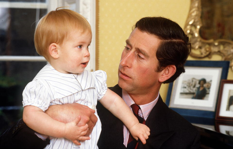 LONDON, UNITED KINGDOM - OCTOBER 04:  Prince Charles With Prince Harry Age One At Home In Kensington Palace.  (Photo by Tim Graham/Getty Images)