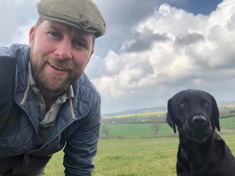 Pictured is Thomas Martin with a dog.