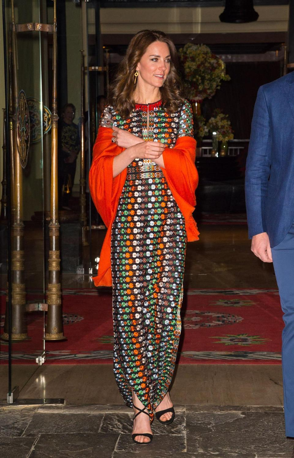<p>Kate and William attended a dinner with the King and Queen of Bhutan. Kate wore a retro floral gown by Tory Burch paired with a vibrant shawl and black Gianvito Rossi sandals. </p><p><i>[Photo: PA]</i></p>