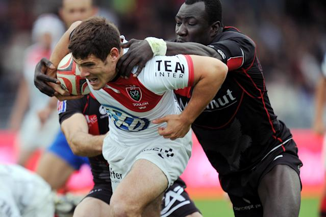 Toulon's French scrum-half Fabien Cibray (L) vies with Lyon's French flanker Eugène N'Zi during the French Top 14 rugby union match Lyon vs.Toulon on May 12, 2012 at the Matmut stadium in Lyon. AFP PHOTO PHILIPPE MERLEPHILIPPE MERLE/AFP/GettyImages