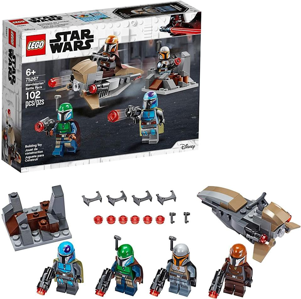 "<p>The <a href=""https://www.popsugar.com/buy/Lego-Star-Wars-Mandalorian-Battle-Pack-551180?p_name=Lego%20Star%20Wars%20Mandalorian%20Battle%20Pack&retailer=amazon.com&pid=551180&price=15&evar1=moms%3Aus&evar9=47243673&evar98=https%3A%2F%2Fwww.popsugar.com%2Ffamily%2Fphoto-gallery%2F47243673%2Fimage%2F47243731%2FLego-Star-Wars-Mandalorian-Battle-Pack&list1=toys%2Ctoy%20fair%2Ckid%20shopping%2Ckids%20toys&prop13=api&pdata=1"" class=""link rapid-noclick-resp"" rel=""nofollow noopener"" target=""_blank"" data-ylk=""slk:Lego Star Wars Mandalorian Battle Pack"">Lego Star Wars Mandalorian Battle Pack</a> ($15) has 102 pieces and is best suited for kids ages 6 and up.</p>"