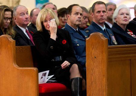 Laureen Harper, wife of Canadian Prime Minister Stephen Harper, cries while attending Cpl. Nathan Cirillo's regimental funeral service in Hamilton, Ontario October 28, 2014. REUTERS/Nathan Denette/Pool