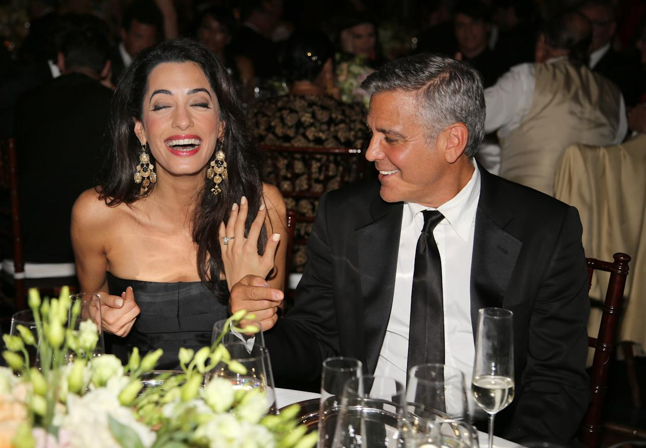 <p>In September 2014, Amal showed off her engagement ring in Florence at Celebrity Fight Night. She wore a black strapless dress and gold chandelier earrings.</p>