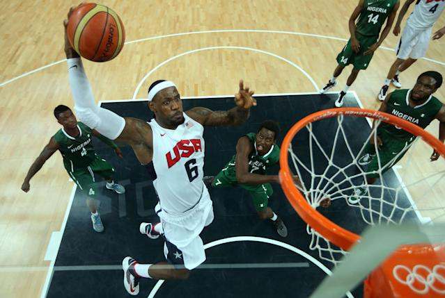 TOPSHOTS US Lebron James (C) shoots against Tony Skinn (L) and Al-Farouq Aminu (2ndR) of Nigeria during the men's preliminary round basketball match USA vs Nigeria of the London 2012 Olympic Games on August 2, 2012 at the basketball arena in London. AFP PHOTO /¨POOL - CHRISTIAN PETERSENChristian Petersen/AFP/GettyImages