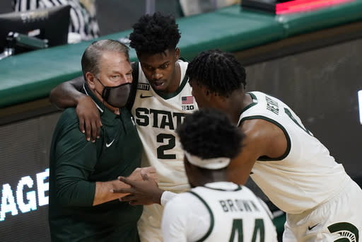 FILE - In this Friday, Dec. 4, 2020, file photo, Michigan State coach Tom Izzo talks to guard Rocket Watts (2) and forward Aaron Henry during the second half of the team's NCAA college basketball game against Detroit Mercy in East Lansing, Mich. Michigan State players, who ate their Thanksgiving meal while on a Zoom call with their various families to keep spirits up on the holiday, had a recruiting room at the Breslin Center temporarily transformed into an arcade and lounge so they could hang out somewhere beside their apartments.Forty years ago, I dont know if I could have done what theyre doing, Izzo said.(AP Photo/Carlos Osorio, File)