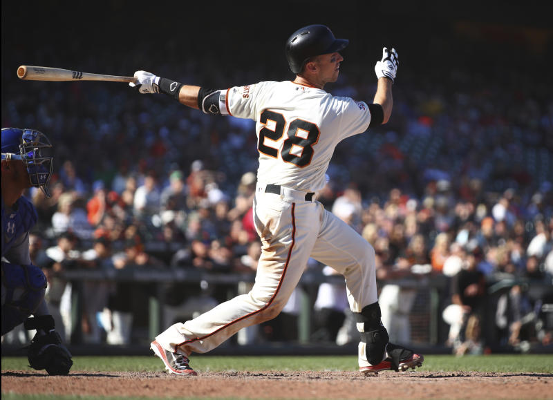 San Francisco Giants' Buster Posey follows through on single that drove in the winning run against the Chicago Cubs in the 13th inning of a baseball game Wednesday, July 11, 2018, in San Francisco. The Giants won 5-4. (AP Photo/Ben Margot)