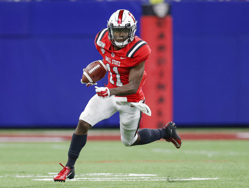 INDIANAPOLIS, IN - AUGUST 31: Justin Hall #11 of the Ball State Cardinals runs the ball during the first half against the Indiana Hoosiers at Lucas Oil Stadium on August 31, 2019 in Indianapolis, Indiana. (Photo by Michael Hickey/Getty Images)