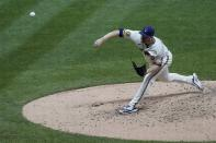 Milwaukee Brewers starting pitcher Brandon Woodruff throws during the fourth inning of a baseball game against the Chicago White Sox Tuesday, Aug. 4, 2020, in Milwaukee. (AP Photo/Morry Gash)