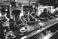 <p>A man and woman speak while seated at Joe Poe's Tavern in rural New Athens, Illinois. Taverns started losing popularity a bit in the late 1970s. (While bars can serve liquor, taverns can only serve beer, wine, cider and food.)</p>