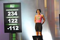 """<p>Ali made history by becoming the first woman to win <em>The Biggest Loser</em> in 2008 during season 5, after she lost 112 pounds. """"Nearly half of me had vanished,"""" she wrote in an essay for <a href=""""https://theweighwewere.com/still-half-her-size/"""" rel=""""nofollow noopener"""" target=""""_blank"""" data-ylk=""""slk:The Weigh We Were"""" class=""""link rapid-noclick-resp"""">The Weigh We Were</a>.</p>"""