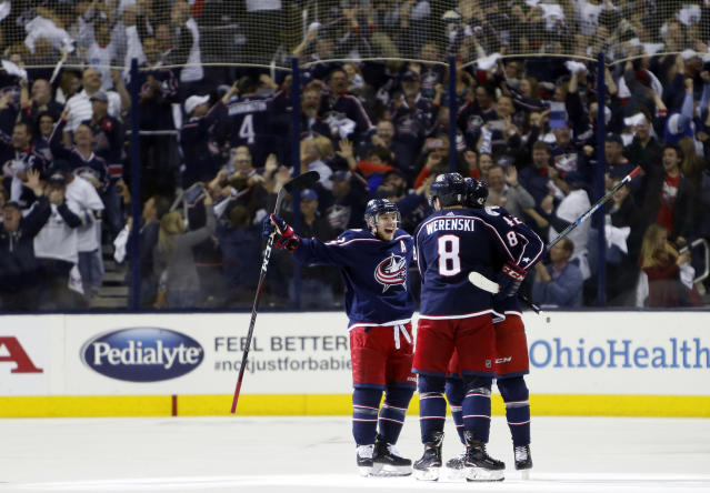 Columbus Blue Jackets players celebrate their goal against the Tampa Bay Lightning during the third period of Game 4 of an NHL hockey first-round playoff series, Tuesday, April 16, 2019, in Columbus, Ohio. The Blue Jackets beat the Lightning 7-3. (AP Photo/Jay LaPrete)