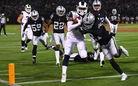 <span>LA Rams running back Todd Gurley scores a touchdown against the Raiders</span> <span>Credit: AP </span>