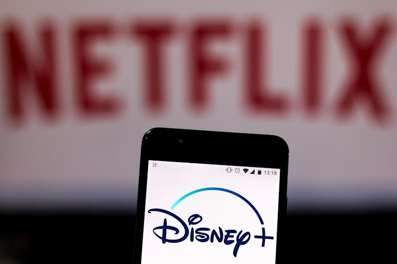 Disney+ Logo with Netflix in the background