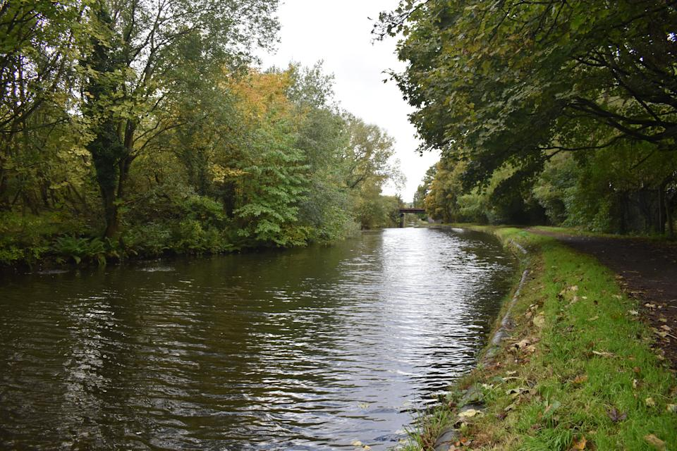 A stretch of canal near Mission Drive in Tipton, West Midlands, which Nathan Maynard-Ellis and David Leesley were alleged to have walked along carrying the dismembered remains of Julia Rawson. (PA)