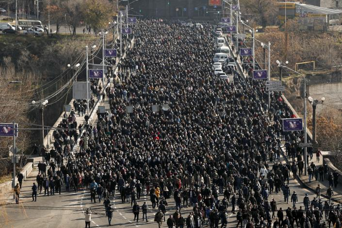 FILE In this file photo taken on Saturday, Dec. 19, 2020, Armenians attend a march of remembrance of the heroes killed during the during the fighting over Nagorno-Karabakh in 2020 year, in Yerevan, Armenia. Armenians head to the polls Sunday for a snap parliamentary election stemming from a political crisis that has engulfed the former Soviet nation ever since last year's fighting over the separatist region of Nagorno-Karabakh. (Tigran Mehrabyan/PAN Photo via AP, File)