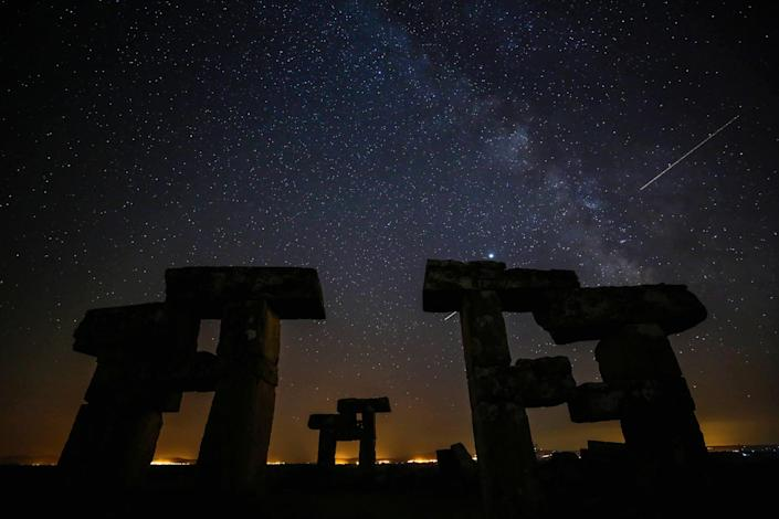 A Perseid meteor streaks across the sky over the ancient city of Blaundus in Usak, Turkey on August 13, 2020. / Credit: Alibey Aydin/Anadolu Agency via Getty Images