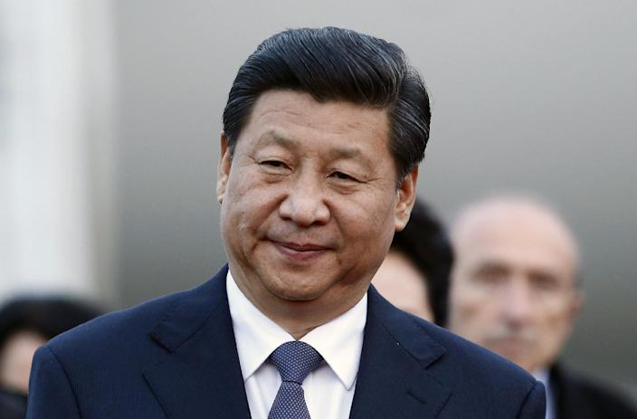 Chinese President Xi Jinping arrives at Lyon airport, central France, Tuesday, March 25, 2014. Xi will later have a dinner at the Lyon town-hall and has arrived in France for a three-day state visit. (AP Photo/Str)