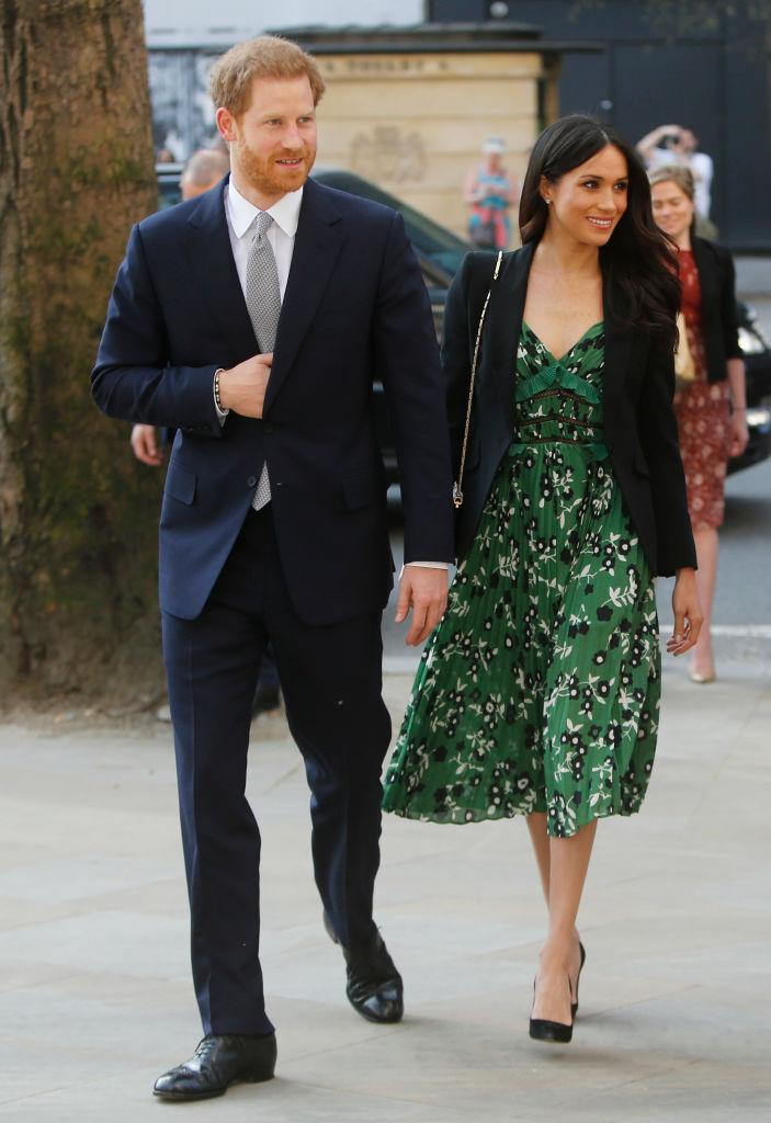 """<p>For the Invictus Games Sydney reception, Meghan Markle kept cool from London's mini heatwave in a spring-ready dress by Self Portrait. She accessorised the covetable look with a black Alexander McQueen blazer and a £695 co-ordinating <a rel=""""nofollow noopener"""" href=""""https://www.rolandmouret.com/products/mini-classico-bag-ps18-c1000"""" target=""""_blank"""" data-ylk=""""slk:bag"""" class=""""link rapid-noclick-resp"""">bag</a> by Roland Mouret. <em>[Photo: Getty]</em> </p>"""