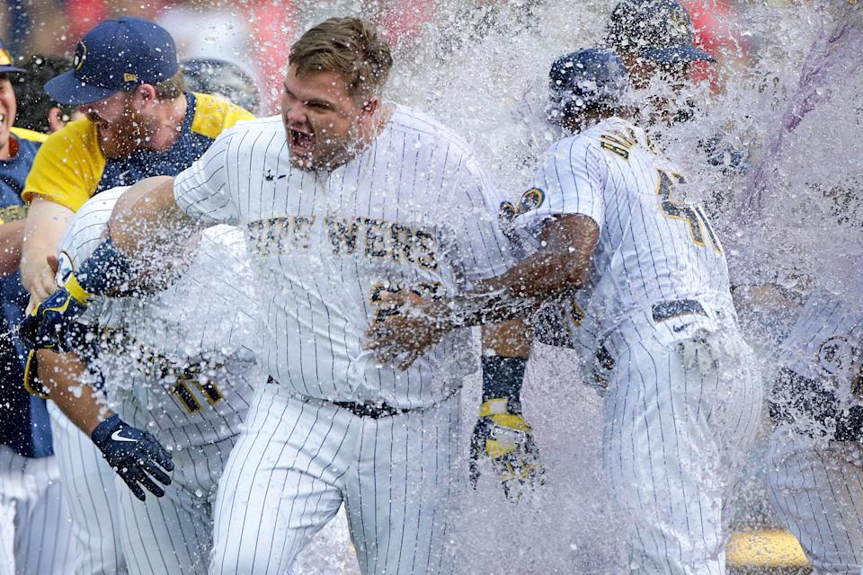 Daniel Vogelbach gets a water and Gatorade bath after hitting a walk-off grand slam in the ninth inning against the St. Louis Cardinals at American Family Field on Sunday.