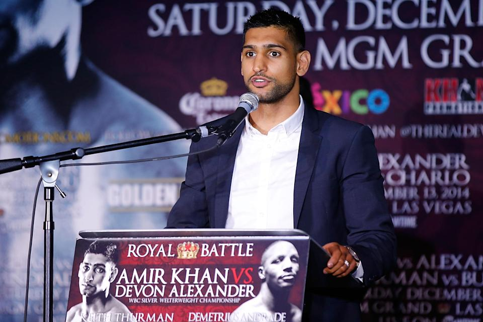 Amir Khan, pictured during the Amir Khan & Devon Alexander Fight Announcement on November 4, 2014 in Los Angeles, was originally scheduled to fight Alexander for the IBF welterweight title last December in New York (AFP Photo/Joe Scarnici)