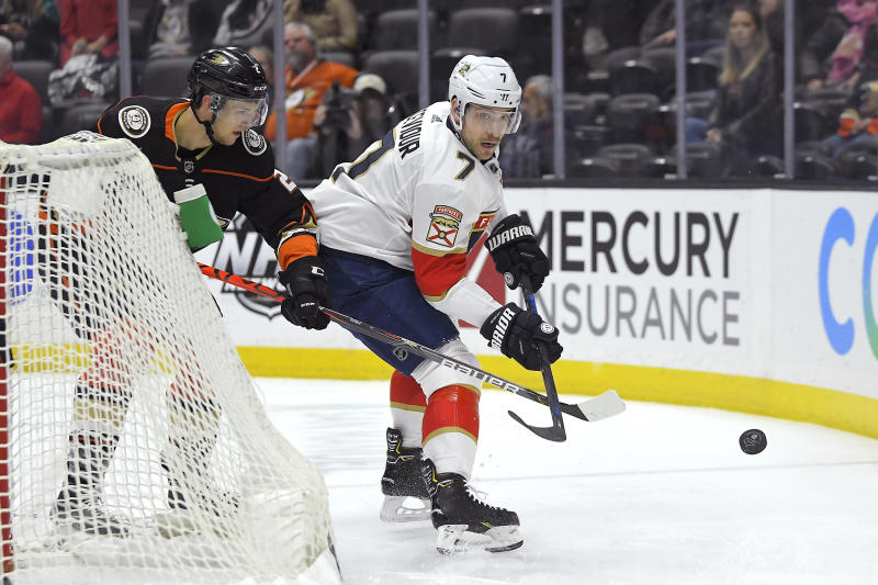Anaheim Ducks defenseman Brendan Guhle, left, and Florida Panthers center Colton Sceviour battle for the puck during the first period of an NHL hockey game Wednesday, Feb. 19, 2020, in Anaheim, Calif. (AP Photo/Mark J. Terrill)