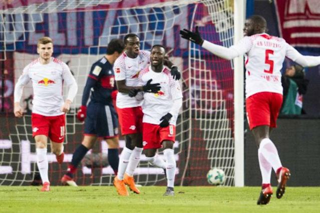 RB Leipzig came from a goal down with Naby Keita scoring once and setting up the other goal to stun Bundesliga leaders Bayern Munich 2-1 on Sunday and rekindle their Champions League hopes.