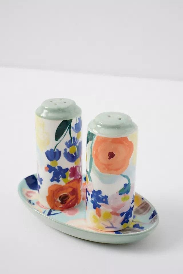 """This shaker set is a floral dream that belongs on the counter rather than tucked in the cupboard. Anthrolopogie has several fun <a href=""""https://cna.st/affiliate-link/3XBo9W39HRd8se4kJoVsdhvtcUKK36A5PiLoGN22BMHLokfkuqxDiCT54JCGrG3Fkb46XX1bw5PZ2J3Yhw7BAZqKRksYsziNo2VpStGXcEuwMqs?cid=60944ec169fc9c275ddf3410"""" rel=""""nofollow noopener"""" target=""""_blank"""" data-ylk=""""slk:shaker sets"""" class=""""link rapid-noclick-resp"""">shaker sets</a>, which make a great gift. The hardest part? Choosing just one. $20, Anthropologie. <a href=""""https://www.anthropologie.com/shop/remi-salt-pepper-shakers"""" rel=""""nofollow noopener"""" target=""""_blank"""" data-ylk=""""slk:Get it now!"""" class=""""link rapid-noclick-resp"""">Get it now!</a>"""