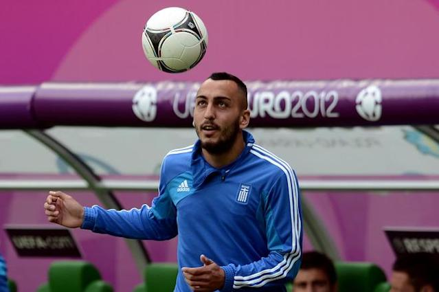 Greece's forward Kostas Mitroglou eyes a ball during a training session in Wroclaw on June 11, 2012, on the eve of the Euro 2012 football championships match against the Czech Republic. AFP PHOTO / ARIS MESSINISARIS MESSINIS/AFP/GettyImages