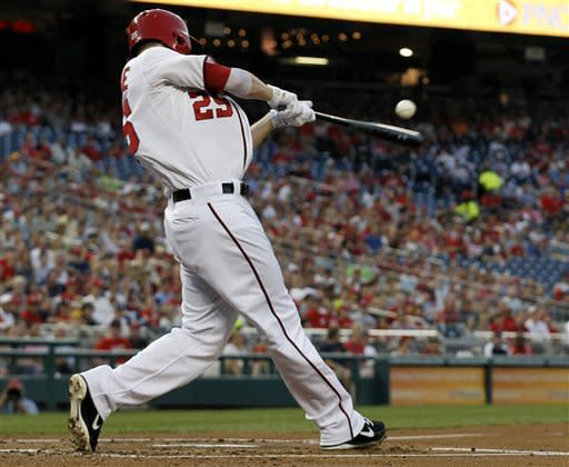 Washington Nationals' Adam LaRoche hits a two-RBI single during the inning of a baseball game against the St. Louis Cardinals at Nationals Park Friday, Aug. 31, 2012, in Washington. (AP Photo/Alex Brandon)