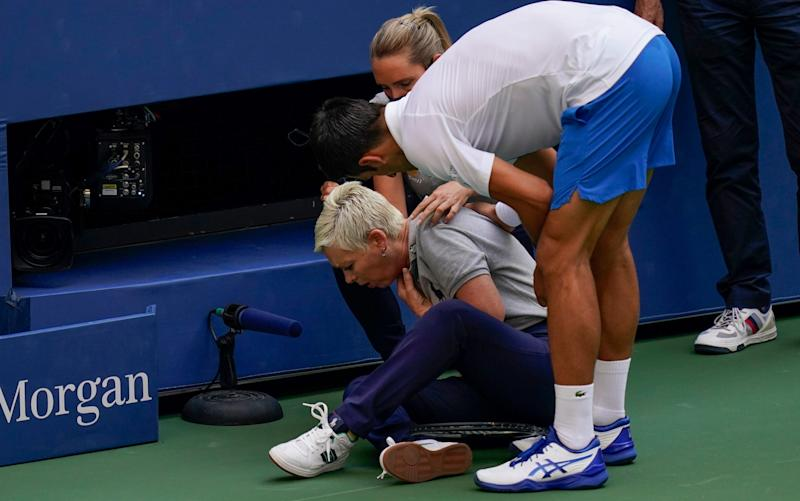 Djokovic checks on the line judge following the fourth round incident - AP