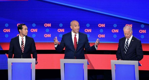 PHOTO: Democratic presidential hopefuls former Secretary of Housing and Urban Development Julian Castro, Sen. Cory Booker and former Vice President Joe Biden speak during the second round of the second Democratic primary debate in Detroit, July 31, 2019. (Jim Watson/AFP/Getty Images)