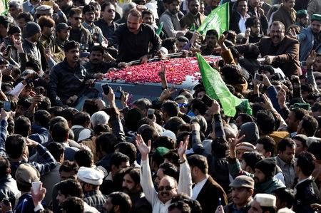 Supporters of former Pakistani Prime Minister Nawaz Sharif gather around a vehicle carrying him as he arrives to appear before an anti-corruption court in Islamabad Pakistan