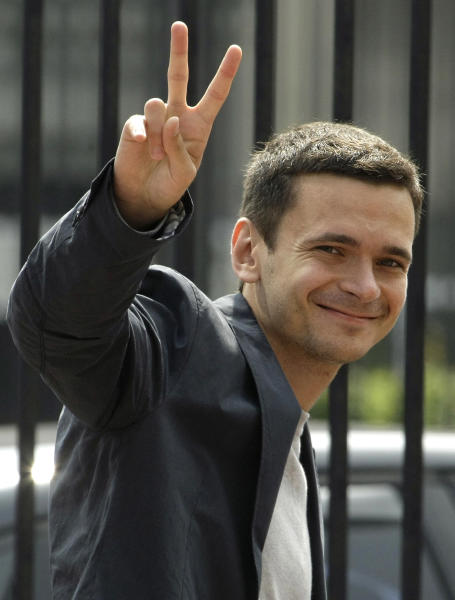 Russian opposition leader Ilya Yashin gestures as arrives for questioning at the headquarters of the Russian Investigation committee in Moscow, Russia, Tuesday, June 12, 2012. Russia's top investigation agency has summoned several key opposition figures for questioning in an apparent bid to disrupt the first massive protest against President Vladimir Putin since his inauguration for a third term. (AP Photo/Mikhail Metzel)