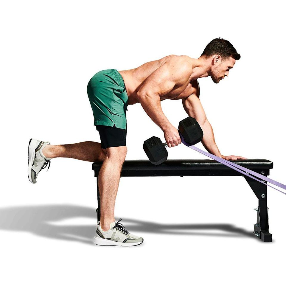 <p>With tension in the band, lift the bell by squeezing your shoulder blades together. This will prevent you from rounding your upper back and shrugging the weight up.</p>